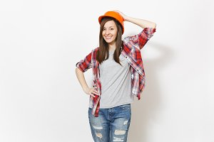 Young smiling beautiful woman in casual clothes and protective construction orange helmet isolated on white background. Instruments, accessories for renovation apartment room. Repair home concept.