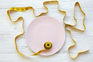 Pink plate with measuring tape