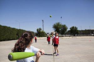 girls playing baseball