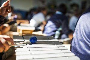 girl playing xylophone