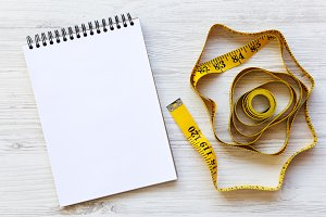 Measuring tape with notepad