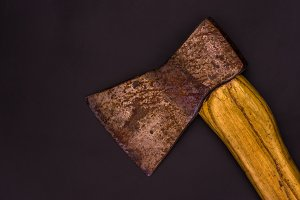 The old ax. Vintage ax. Ax with a wooden handle. Top.