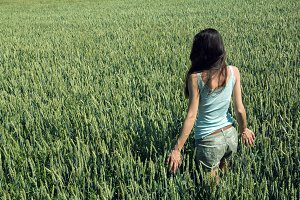 a girl in a wheat field