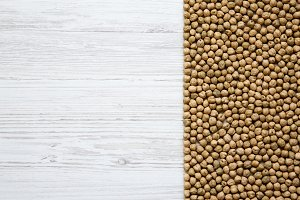 Dried chickpeas on a white wooden