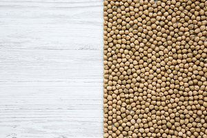 Dried chick peas on white wooden
