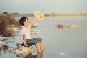 happy child with hat in the beach