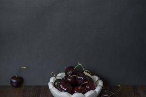 cherries in marble bowl