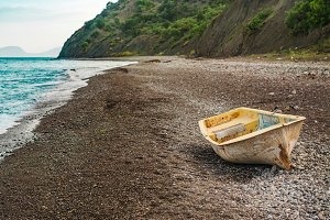 Lonely boat on the sunset beach