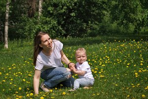 Family. Mom and son in meadow.
