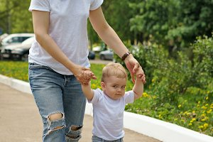 Family. Mom and son are walking.