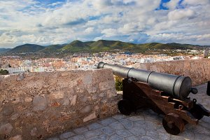 Old cannon and panorama of Ibiza
