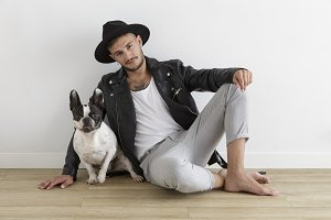 Hipster boy with French Bulldog dog on white background