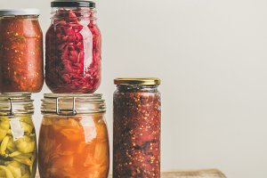 Autumn seasonal pickled or fermented vegetables in jars. Home canning