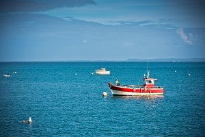 Bright blue sea and fisherman boats