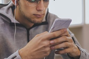 young fashion with mobile phone and earphones