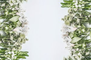 Layout with green flowers on white