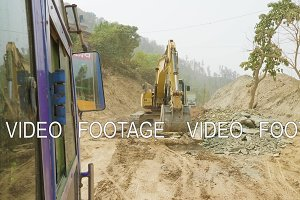 Excavator repair the road in Nepal.
