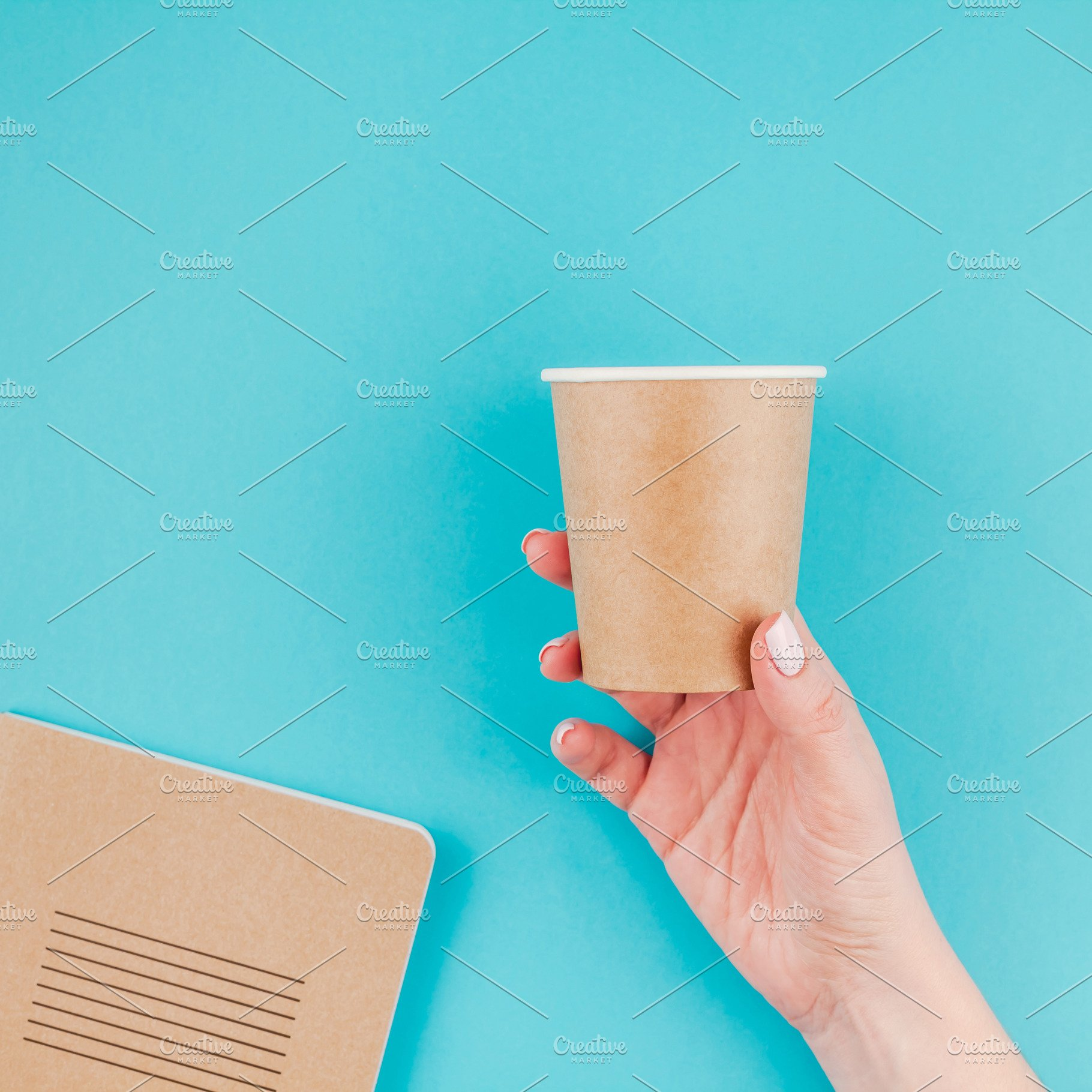 Woman Hand With Craft Paper Cup And