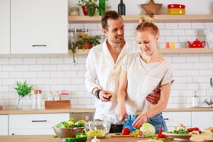 Image of young couple in love preparing breakfast in kitchen