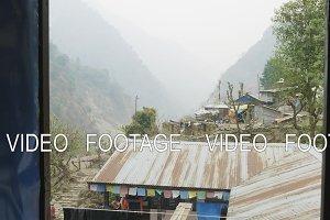 Flying in Nepalese village on the Manaslu circuit trek.
