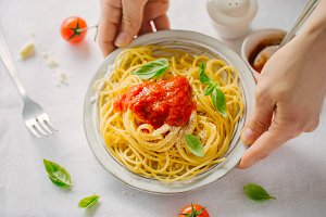 Serving pasta dish with tomato sauce