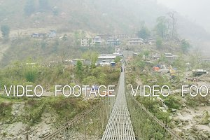 Way to the village through the suspension bridge over the river in Nepal.