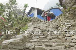Backpackers walk to the village on the Manaslu circuit trek.