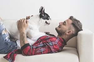 French Bulldog dog with affectionate attitude with his owner