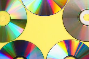 Piles of old and dirty CDs,DVD on pastel background. Used and dusty disk with copy space for add text.