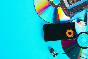 The concept of the evolution of music. Cassette, CD-disk, mp3 player. Vintage and modernity. Music support.