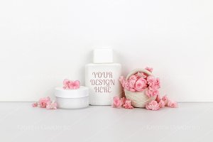 Cosmetics mockup with pink flowers