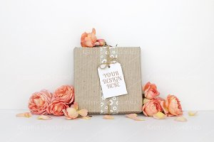 Gift box with a tag mockup, flowers