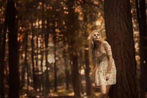 The beautiful blonde in a forest