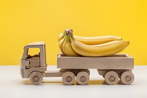Wooden toy truck with bananas.