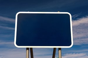 Blank road sign with blue background