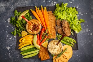 hummus with vegetables and snacks