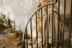 Girl in leopard skirt on stairs