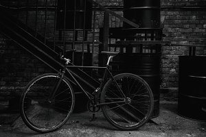 Bicycle at the stairs and barrels