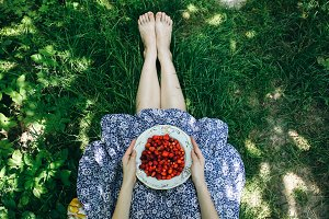 Woman is holding strawberries