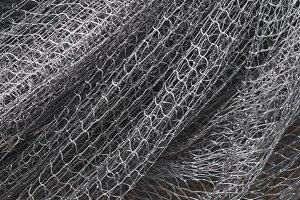 Gray texture fishing net. Close up p