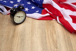 USA flag and alarm clock