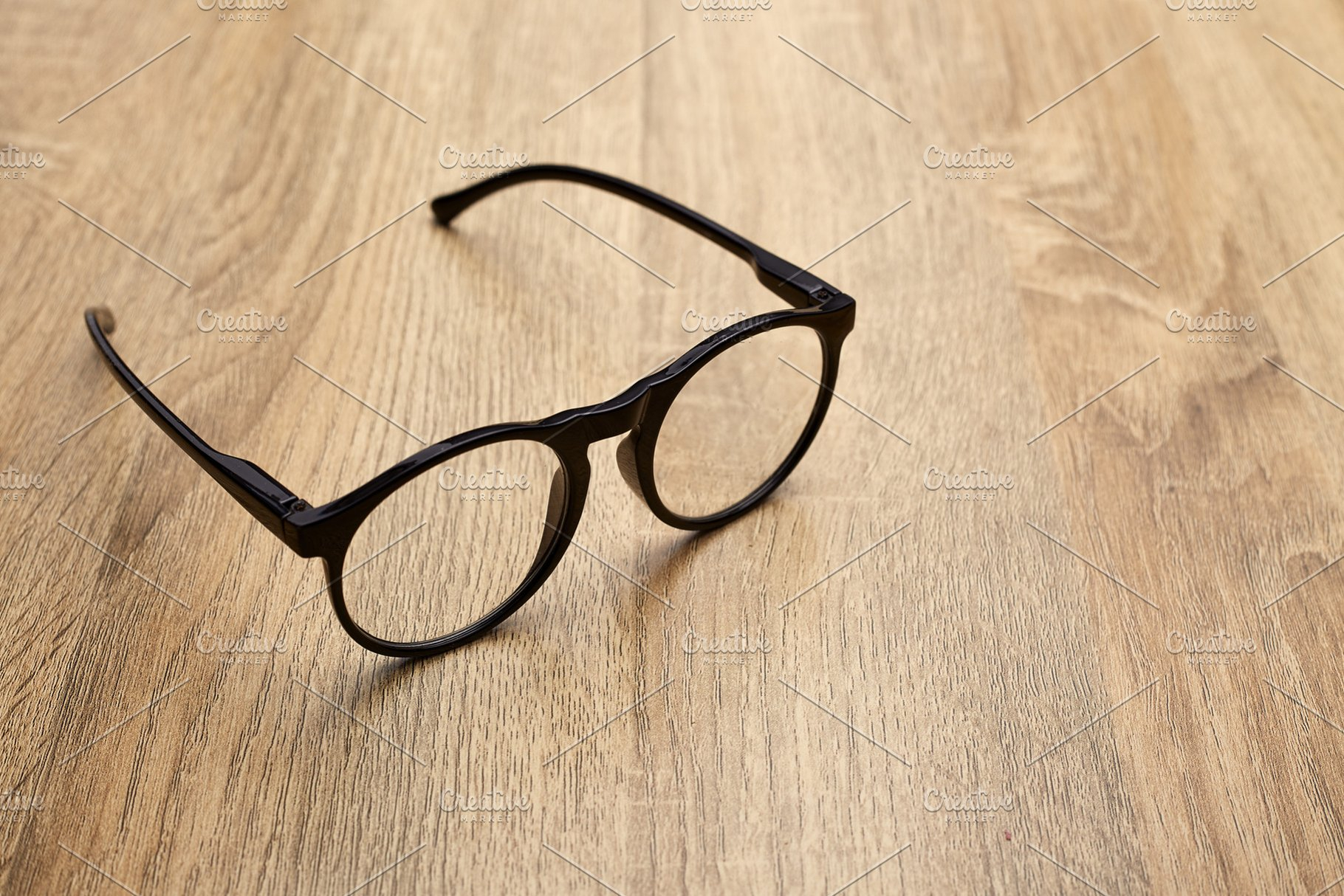 3de3400962be Close Up Of Eyeglasses On Table ~ Health Photos ~ Creative Market