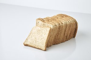whole wheat bread sliced on white