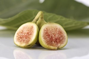 Fresh green figs on white background