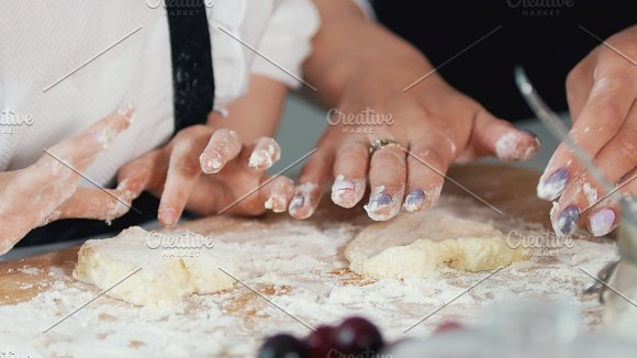 Female hands forms homemade pancakes from cottage cheese in Graphics