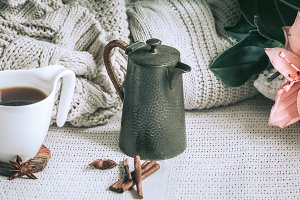 a cup of tea and knitted sweaters