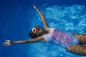 Woman inside the pool enjoying happy
