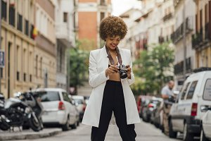 Female photographer visiting Madrid