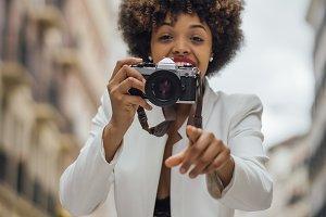 Female photographer visiting Madrid