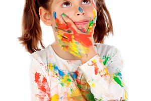 Child with hands and face with paint